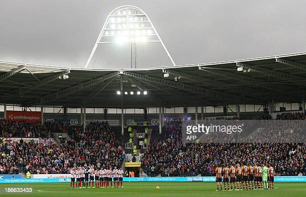 Sunderland and Hull City players hold one minute of silence in memory of those who lost their lives fighting for England in world wars prior to the...