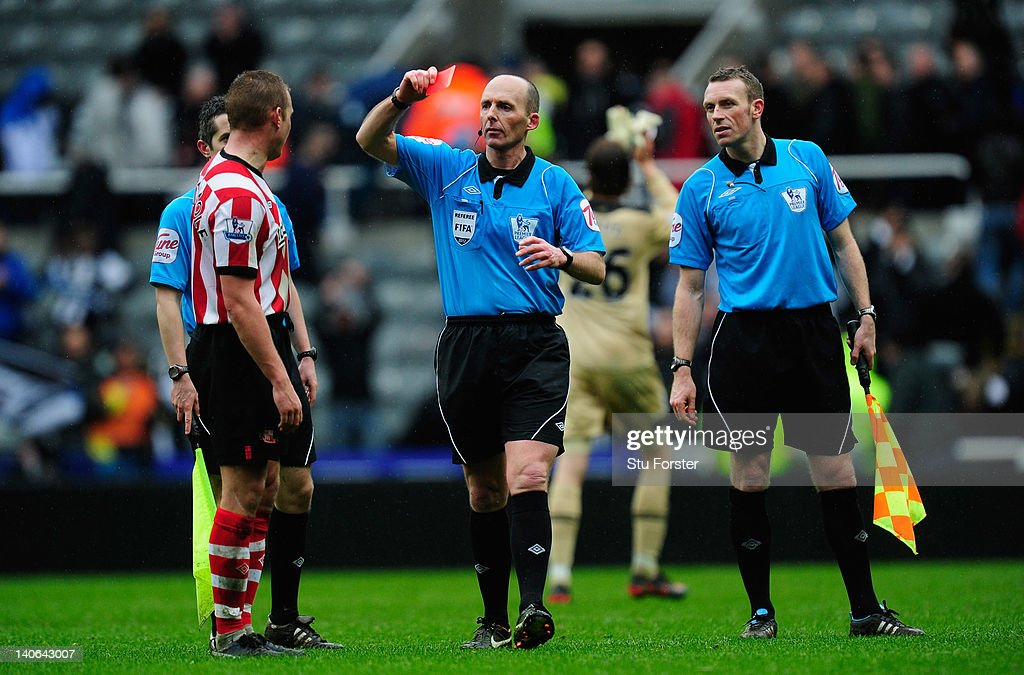 Sunderland captain <a gi-track='captionPersonalityLinkClicked' href=/galleries/search?phrase=Lee+Cattermole&family=editorial&specificpeople=646988 ng-click='$event.stopPropagation()'>Lee Cattermole</a> (l) is sent off after the game by referee <a gi-track='captionPersonalityLinkClicked' href=/galleries/search?phrase=Mike+Dean+-+Referee&family=editorial&specificpeople=4517613 ng-click='$event.stopPropagation()'>Mike Dean</a> after the Barclays Premier League match between Newcastle United and Sunderland at Sports Direct Arena on March 4, 2012 in Newcastle upon Tyne, England.