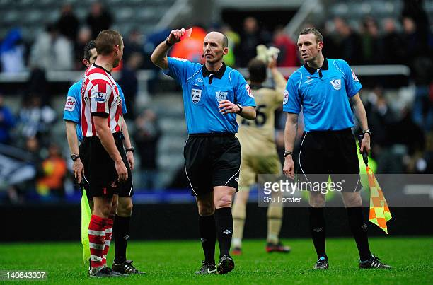 Sunderland captain Lee Cattermole is sent off after the game by referee Mike Dean after the Barclays Premier League match between Newcastle United...