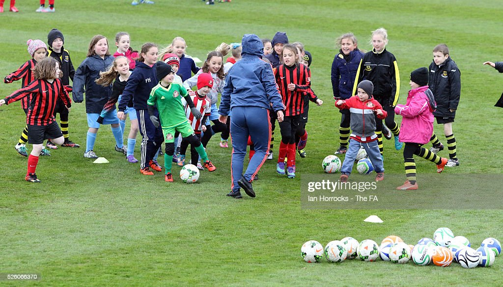 Sunderland coaches put children through their paces before the WSL 1 match between Sunderland AFC Ladies and Manchester City Women at The Hetton Center on April 29, 2016 in Hetton, England.