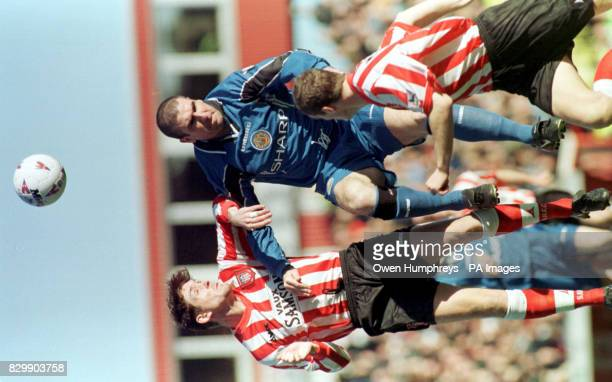 Sunderland defender Richard Ord clashes in midair with Manchester United's striker Eric Cantona at Roker Park todayPhoto Owen Humphreys / PA