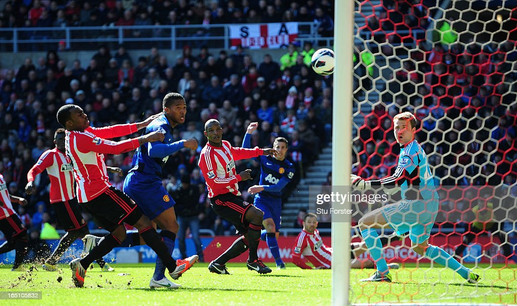 Sunderland defender <a gi-track='captionPersonalityLinkClicked' href=/galleries/search?phrase=Titus+Bramble&family=editorial&specificpeople=217707 ng-click='$event.stopPropagation()'>Titus Bramble</a> (c) deflects <a gi-track='captionPersonalityLinkClicked' href=/galleries/search?phrase=Robin+Van+Persie&family=editorial&specificpeople=214179 ng-click='$event.stopPropagation()'>Robin Van Persie</a>'s shot into his own net for the winning goal during the Barclays Premier League match between Sunderland and Manchester United at Stadium of Light on March 30, 2013 in Sunderland, England.