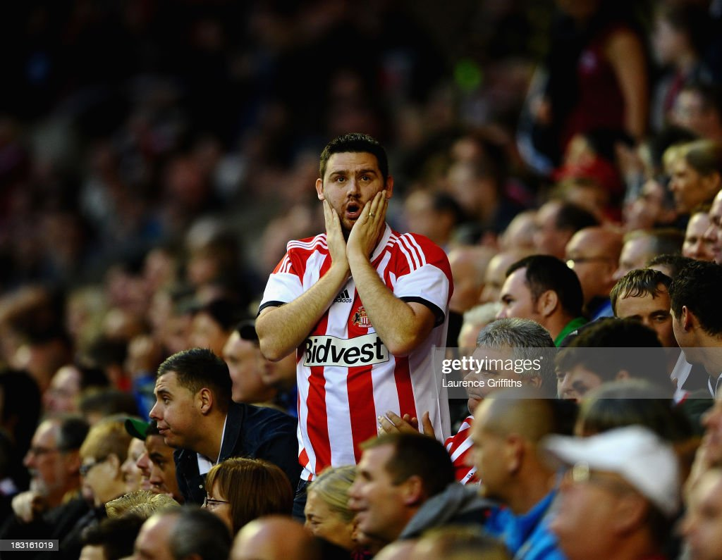 A Sunderland fan reacts during the Barclays Premier League match between Sunderland and Manchester United at Stadium of Light on October 5, 2013 in Sunderland, England.