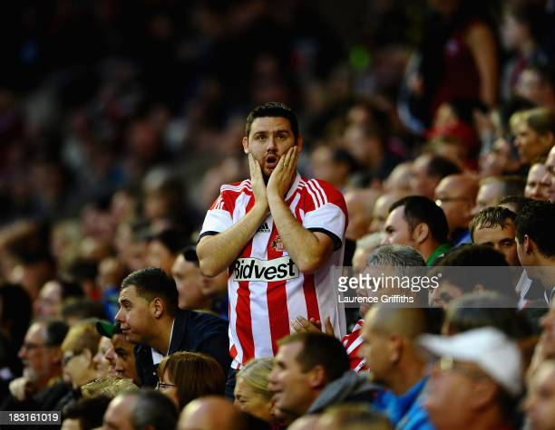 Sunderland fan reacts during the Barclays Premier League match between Sunderland and Manchester United at Stadium of Light on October 5 2013 in...