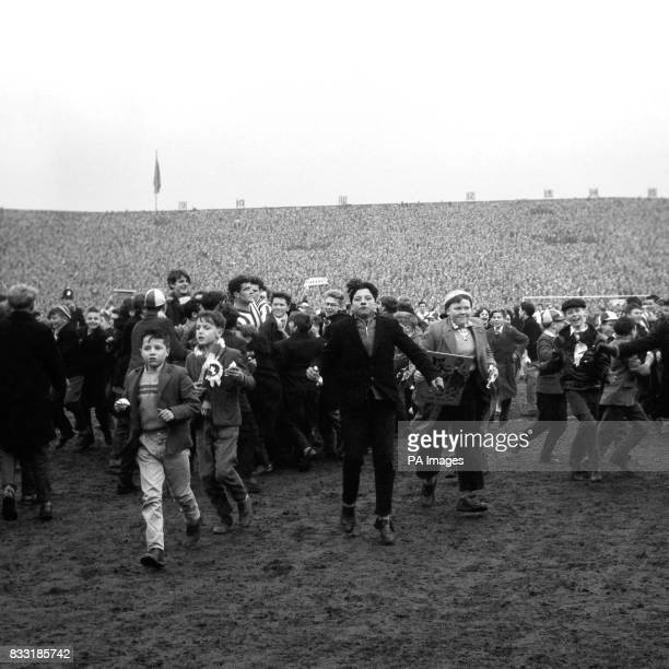 Sunderland football fans swarm onto the pitch at Roker Park after Willie McPheat scored their team's equalising goal