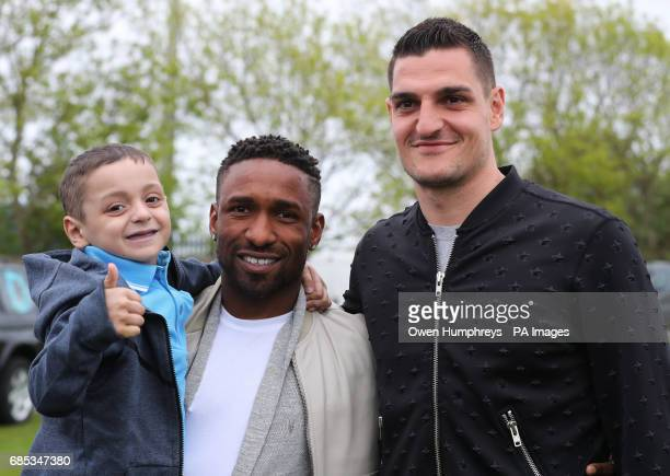 Sunderland footballers Jermain Defoe and Vito Mannone with terminally ill football mascot Bradley Lowery as he celebrates his sixth birthday at...