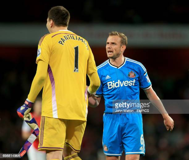 Sunderland goalkeeper Costel Pantilimon and Lee Cattermole celebrate avoiding relegation
