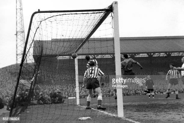 Sunderland goalkeeper Peter Wakeham with Colin Nelson and Len Ashurst watching helplessly as Tottenham Hotspur's first goal enters the net scored by...