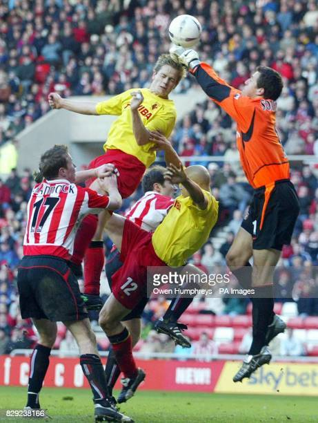 Sunderland goalkeeper Thomas Sorrenson jumps with Watford's Heidar Helguson during their FA Cup Fifth round match at the Stadium of Light Sunderland...
