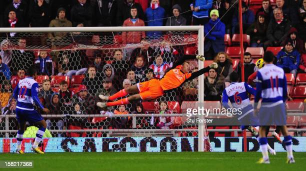 Sunderland keeper Simon Mignolet produces a diving stop during the Barclays Premier League match between Sunderland and Reading at Stadium of Light...