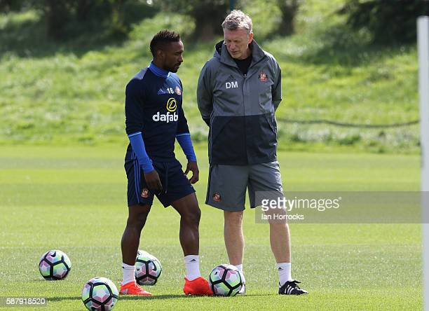 Sunderland manager David Moyes talks with Jermain Defoe during a Sunderland AFC training session at The Academy of Light on August 10 2016 in...