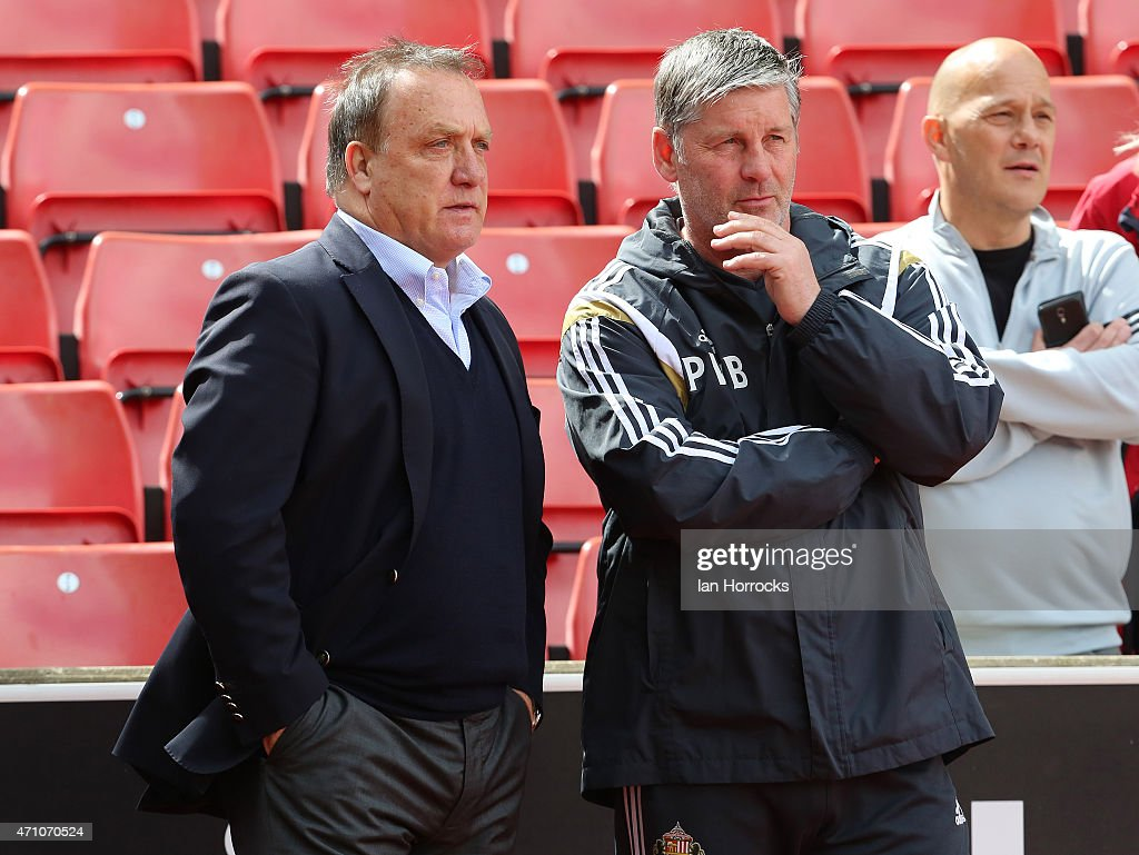 Sunderland manager Dick Advocaat chats with coach Paul Bracewell during the Barclays Premier League match between Stoke City and Sunderland AFC at...