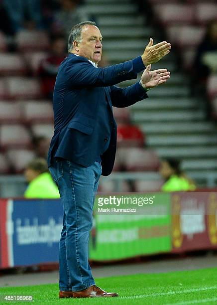Sunderland manager Dick Advocaat gestures to his team during the Capital One Cup Second Round match between Sunderland and Exeter City at Stadium of...