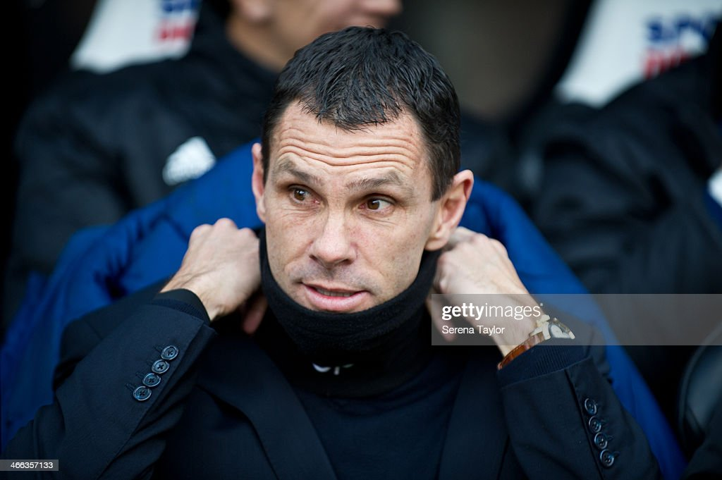 Sunderland manager Gus Poyet adjusts his collar during the Barclays Premier League match between Newcastle United and Sunderland at St. James' Park on February 01, 2013, in Newcastle upon Tyne, England.
