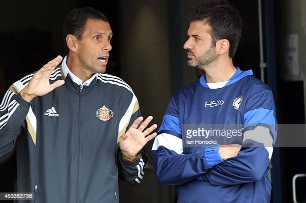Sunderland manager Gus Poyet chats with Udinese head coach Andrea Stramaccioni during a preseason friendly match between Sunderland AFC and Udinese...