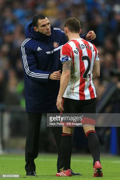 Sunderland manager Gus Poyet consoles Phil Bardsley after the final whistle