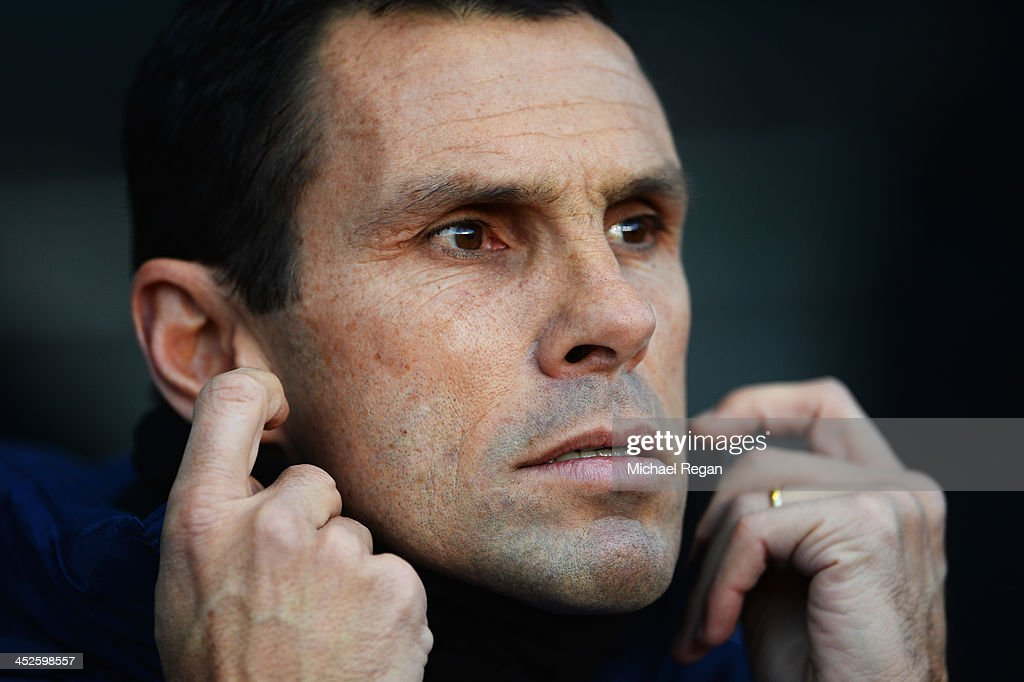 Sunderland manager Gus Poyet looks on before the start of the Barclays Premier League match between Aston Villa and Sunderland at Villa Park on November 30, 2013 in Birmingham, England.