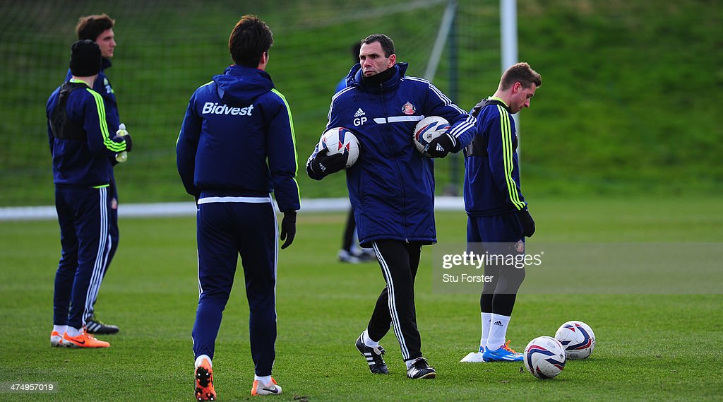 Sunderland manager Gus Poyet (c) looks on during Sunderland training ahead of sunday's Capital One Cup Final against Manchester City at the Academy of Light on February 26, 2014 in Sunderland, England.