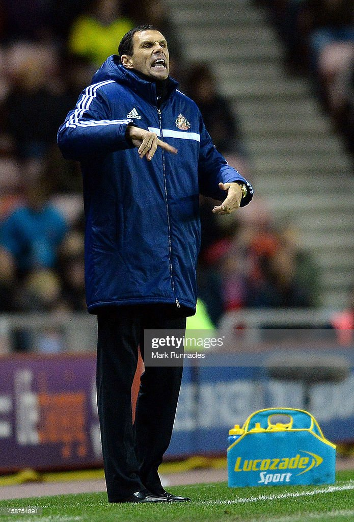 Sunderland manager Gus Poyet reacts during the Barclays Premier League match between Sunderland and Norwich City at the Stadium of Light on December 21, 2013 in Sunderland, England.