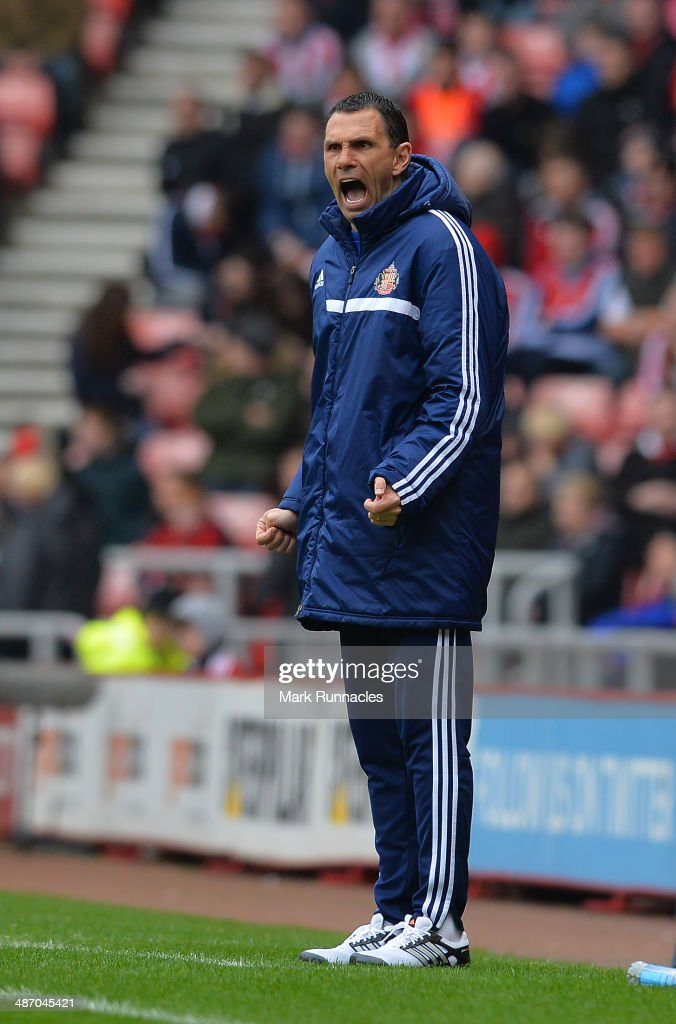 Sunderland manager Gus Poyet reacts during the Barclays Premier League match between Sunderland and Cardiff City at the Stadium of Light on April 27 2014 in Sunderland, England.