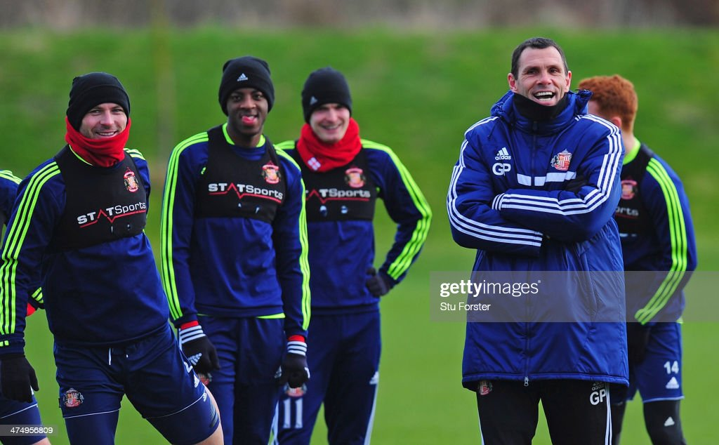 Sunderland manager Gus Poyet (r) shares a joke with his players during Sunderland training ahead of sunday's Capital One Cup Final against Manchester City at the Academy of Light on February 26, 2014 in Sunderland, England.