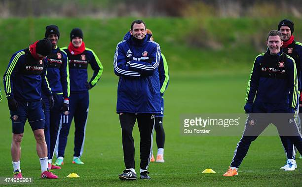 Sunderland manager Gus Poyet shares a joke with his players during Sunderland training ahead of sunday's Capital One Cup Final against Manchester...