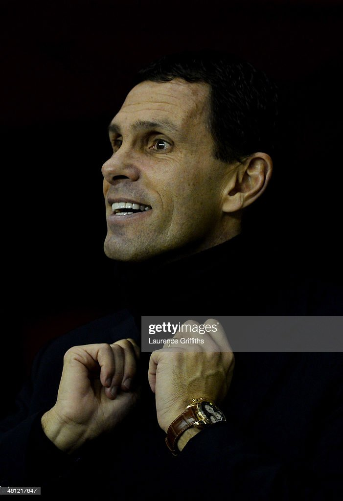 Sunderland manager <a gi-track='captionPersonalityLinkClicked' href=/galleries/search?phrase=Gustavo+Poyet&family=editorial&specificpeople=227352 ng-click='$event.stopPropagation()'>Gustavo Poyet</a> looks on prior to the Capital One Cup Semi-Final, first leg match between Sunderland and Manchester United at Stadium of Light on January 7, 2014 in Sunderland, England.