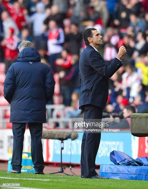 Sunderland manager Gustavo Poyet turns to celebrate their first goal scored by Phil Bardsley