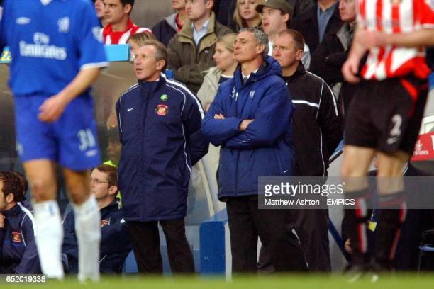 Sunderland manager Howard Wilkinson and Chelsea manager Claudio Ranieri watch the game