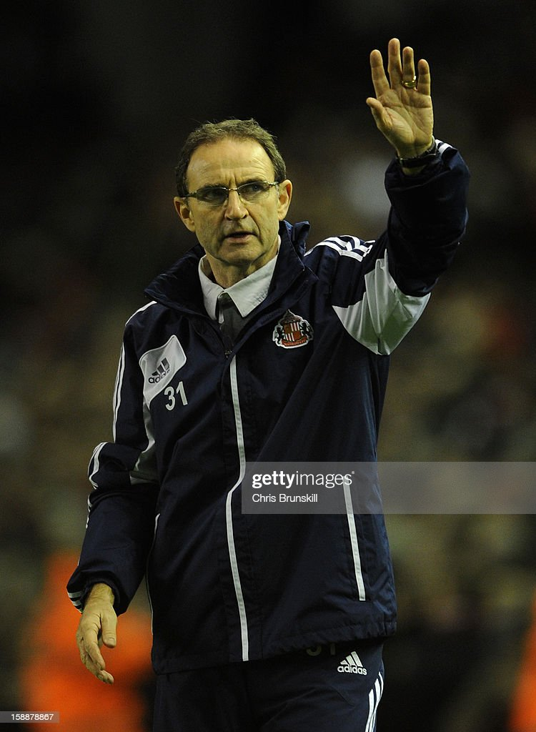 Sunderland Manager Martin O'Neill acknowledges the crowd at the end of the Barclays Premier League match between Liverpool and Sunderland at Anfield on January 2, 2013 in Liverpool, England.