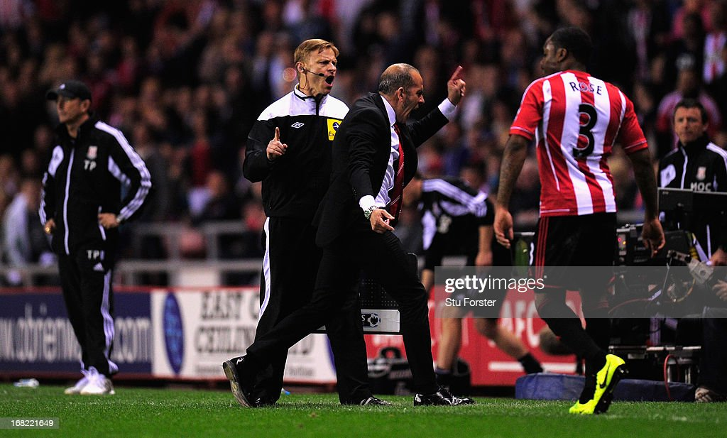 Sunderland manager <a gi-track='captionPersonalityLinkClicked' href=/galleries/search?phrase=Paolo+Di+Canio&family=editorial&specificpeople=215237 ng-click='$event.stopPropagation()'>Paolo Di Canio</a> (c) is escorted off the pitch by 4th referee Mike Jones during the Barclays Premier League match between Sunderland and Stoke City at the Stadium of Light on May 06, 2013 in Sunderland, England.