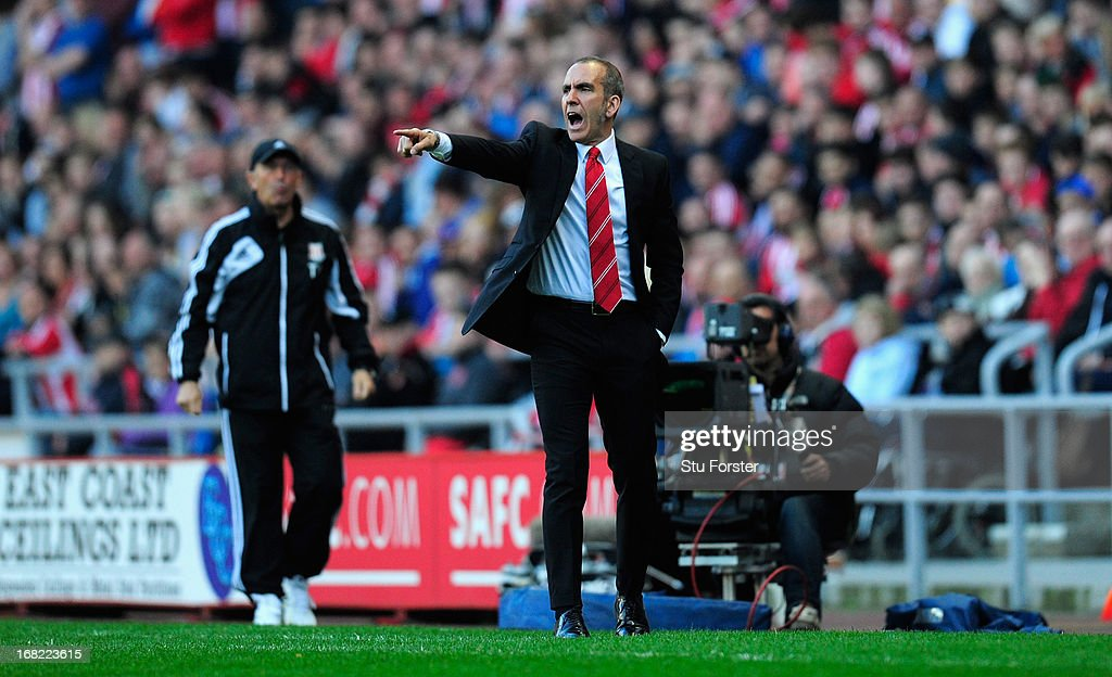 Sunderland manager <a gi-track='captionPersonalityLinkClicked' href=/galleries/search?phrase=Paolo+Di+Canio&family=editorial&specificpeople=215237 ng-click='$event.stopPropagation()'>Paolo Di Canio</a> (r) make his point during the Barclays Premier League match between Sunderland and Stoke City at the Stadium of Light on May 06, 2013 in Sunderland, England.