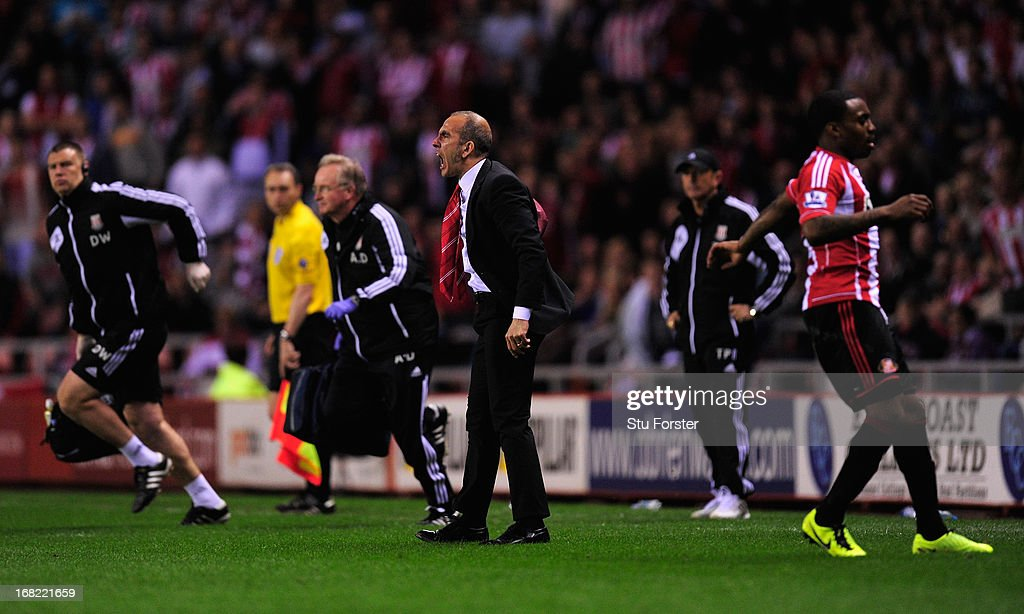 Sunderland manager <a gi-track='captionPersonalityLinkClicked' href=/galleries/search?phrase=Paolo+Di+Canio&family=editorial&specificpeople=215237 ng-click='$event.stopPropagation()'>Paolo Di Canio</a> (c) marches onto the pitch to make his point during the Barclays Premier League match between Sunderland and Stoke City at the Stadium of Light on May 06, 2013 in Sunderland, England.