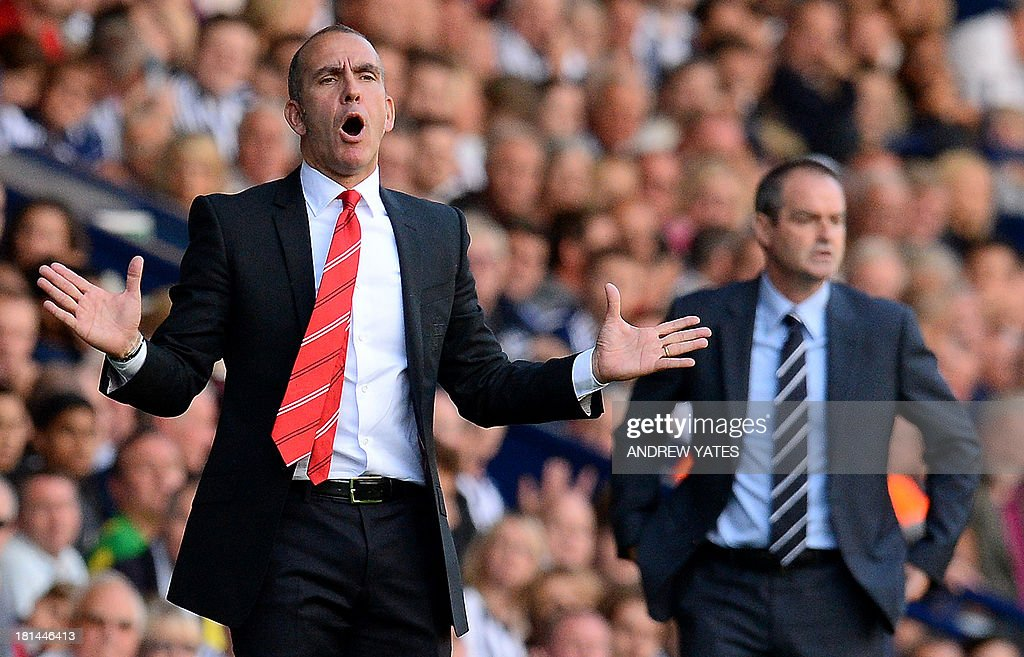 Sunderland manager Paolo Di Canio (L) reacts during the English Premier League football match between West Bromwich Albion and Sunderland at The Hawthorns in West Bromwich, central England, on September 21, 2013. West Bromwich Albion won 3-0. USE. No use with unauthorized audio, video, data, fixture lists, club/league logos or live services. Online in-match use limited to 45 images, no video emulation. No use in betting, games or single club/league/player publications.