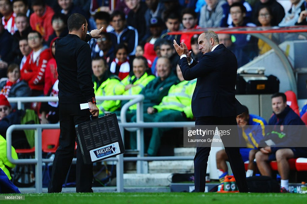 Sunderland manager Paolo Di Canio reacts to fourth official Kevin Friend during the Barclays Premier League match between Sunderland and Arsenal at the Stadium of Light on September 14, 2013 in Sunderland, England.