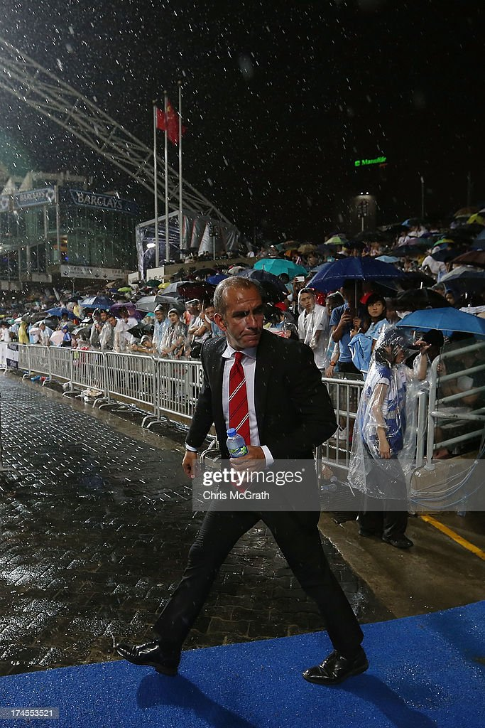 Sunderland manager Paolo Di Canio walks onto the pitch for the second half of the Barclays Asia Trophy Final match between Manchester City and Sunderland at Hong Kong Stadium on July 27, 2013 in So Kon Po, Hong Kong.