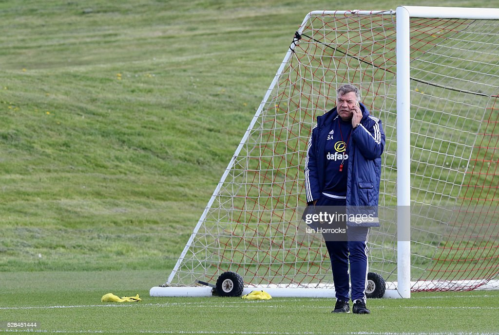 Sunderland manager Sam Allardyce chats on the phone during a Sunderland training session at The Academy of Light on May 5, 2016 in Sunderland, England.