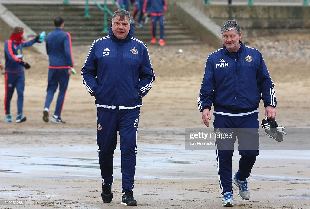 Sunderland manager Sam Allardyce walks with Paul Bracewell during a Sunderland training Session at Roker Beach on April 05 2016 in Sunderland England