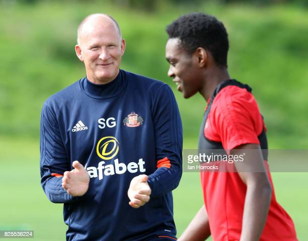 Sunderland manager Simon Grayson shares a joke with Joel Asoro during a Sunderland AFC training session at The Academy of Light on August 2 2017 in...