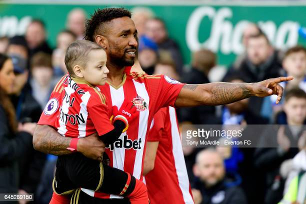 Sunderland mascot Bradley Lowery in the arms of Jermain Defoe during the Premier League match between Everton and Sunderland at Goodison Park on...