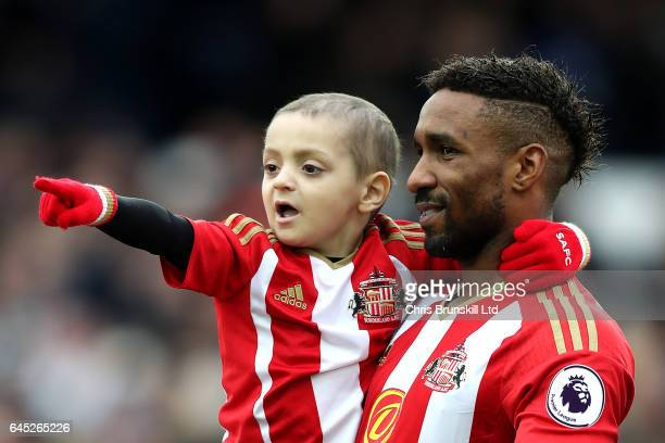 Sunderland mascot Bradley Lowery points to the crowd as Jermaine Defoe looks on ahead of during the Premier League match between Everton and...