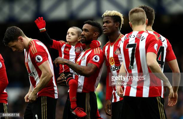 Sunderland mascot Bradley Lowery waves to the crowd as Jermain Defoe looks on ahead of the Premier League match between Everton and Sunderland at...