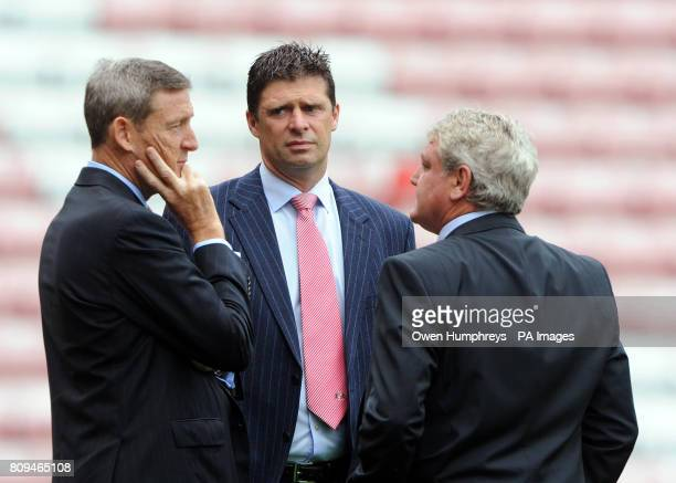 Sunderland owner Ellis Short Chairman Niall Quinn and manager Steve Bruce in discussions ahead of the Barclays Premier League match at the Stadium of...
