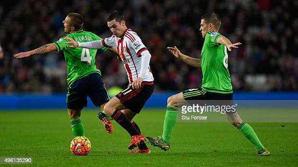 Sunderland player Adam Johnson battles with Jordy Clasie and Steven Davies during the Barclays Premier League match between Sunderland and...