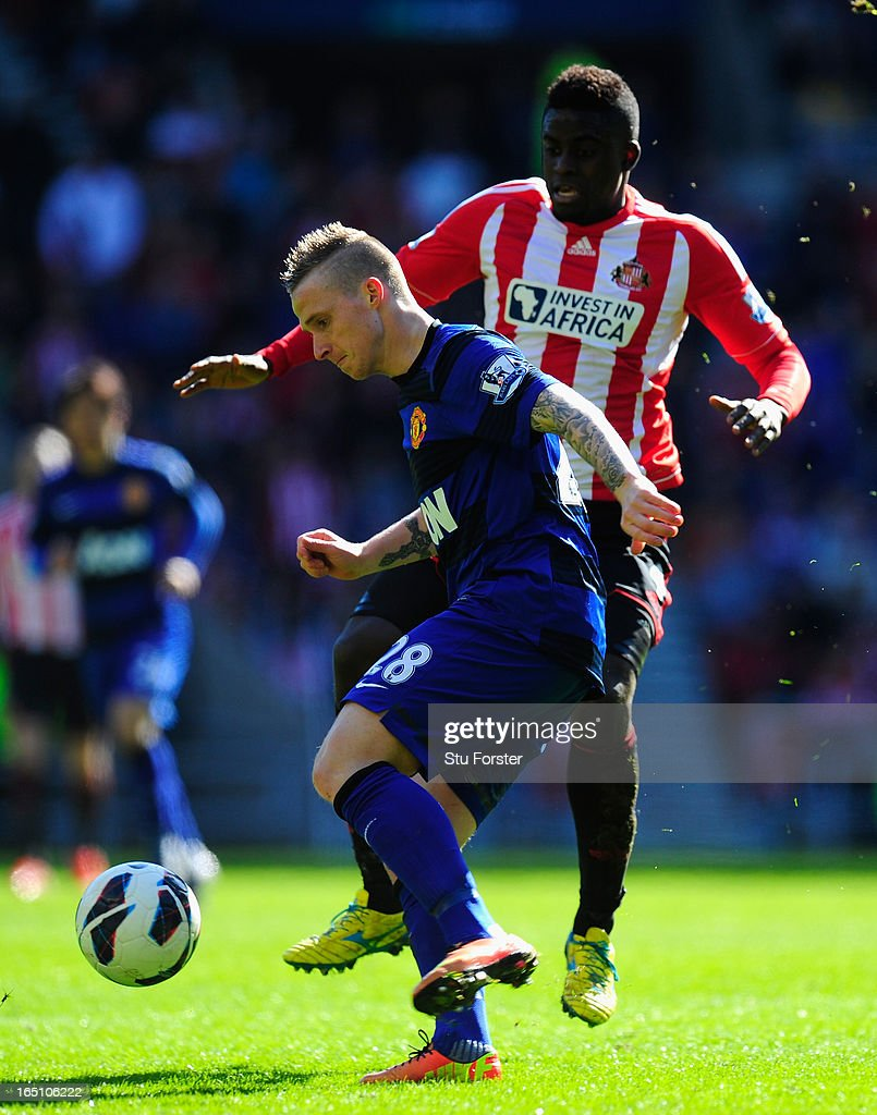 Sunderland player Alfred N' Diaye (r) challenges Alex Buttner during the Barclays Premier League match between Sunderland and Manchester United at Stadium of Light on March 30, 2013 in Sunderland, England.