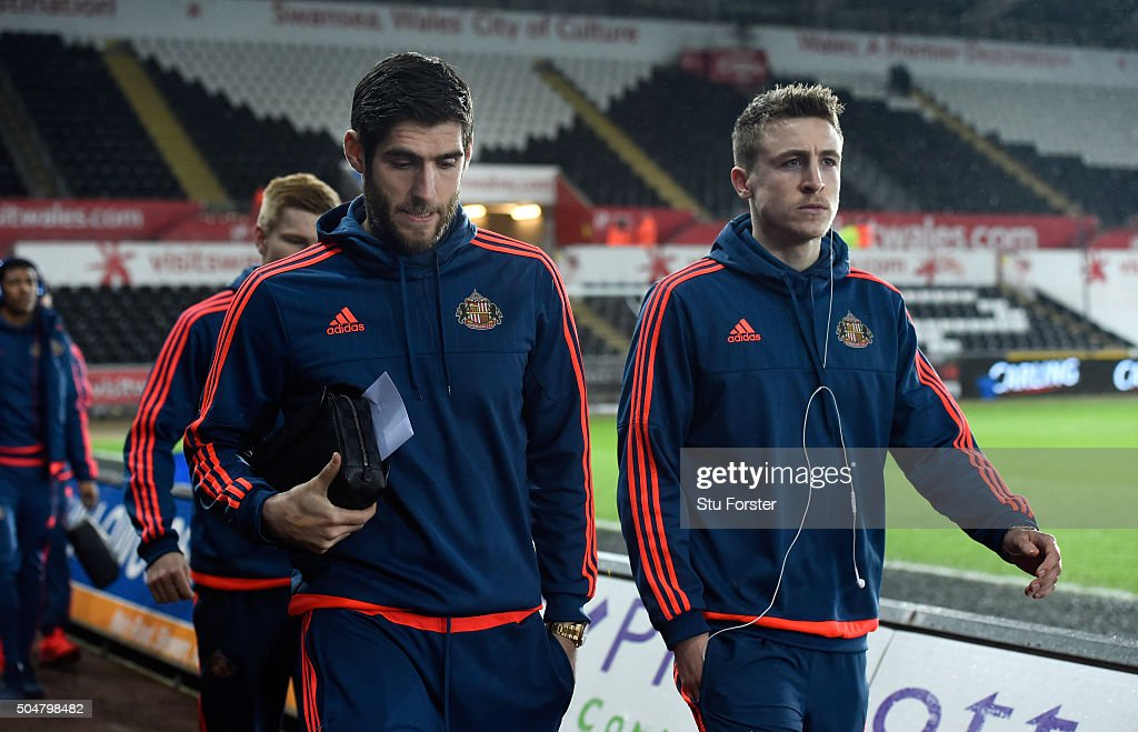 Sunderland player and former Swansea striker <a gi-track='captionPersonalityLinkClicked' href=/galleries/search?phrase=Danny+Graham+-+Soccer+Player&family=editorial&specificpeople=11679831 ng-click='$event.stopPropagation()'>Danny Graham</a> (l) and team mates arrive at the stadium before the Barclays Premier League match between Swansea City and Sunderland at Liberty Stadium on January 13, 2016 in Swansea, Wales