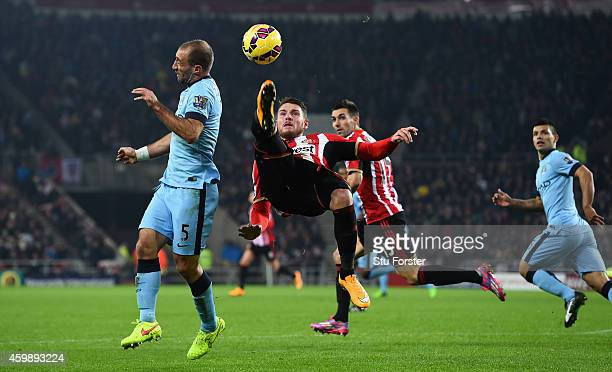 Sunderland player Connor Wickham clears the ball despite the attentions of Pablo Zabaleta during the Barclays Premier League match between Sunderland...