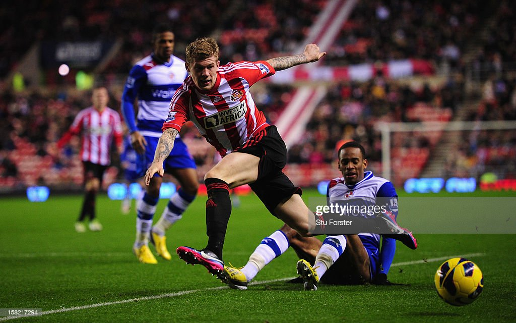 Sunderland player James McClean (l) skips the challenge of Shaun Cummings during the Premier League match between Sunderland and Reading at Stadium of Light on December 11, 2012 in Sunderland, England.