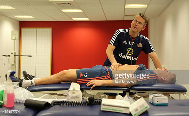 Sunderland player Jordan Pickford is examined by medical staff during the first day back in training for the 201516 Season at The Academy of Light on...