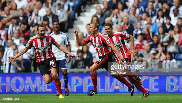 Sunderland player Lee Cattermole celebrates after scoring the opening goal during the Barclays Premier League match between West Bromwich Albion and...
